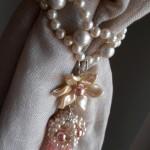 Pink tieback pearls and flowers