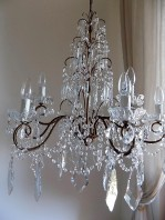 Italian vintage 9 arms solid brass chandelier with rare-shaped crystals