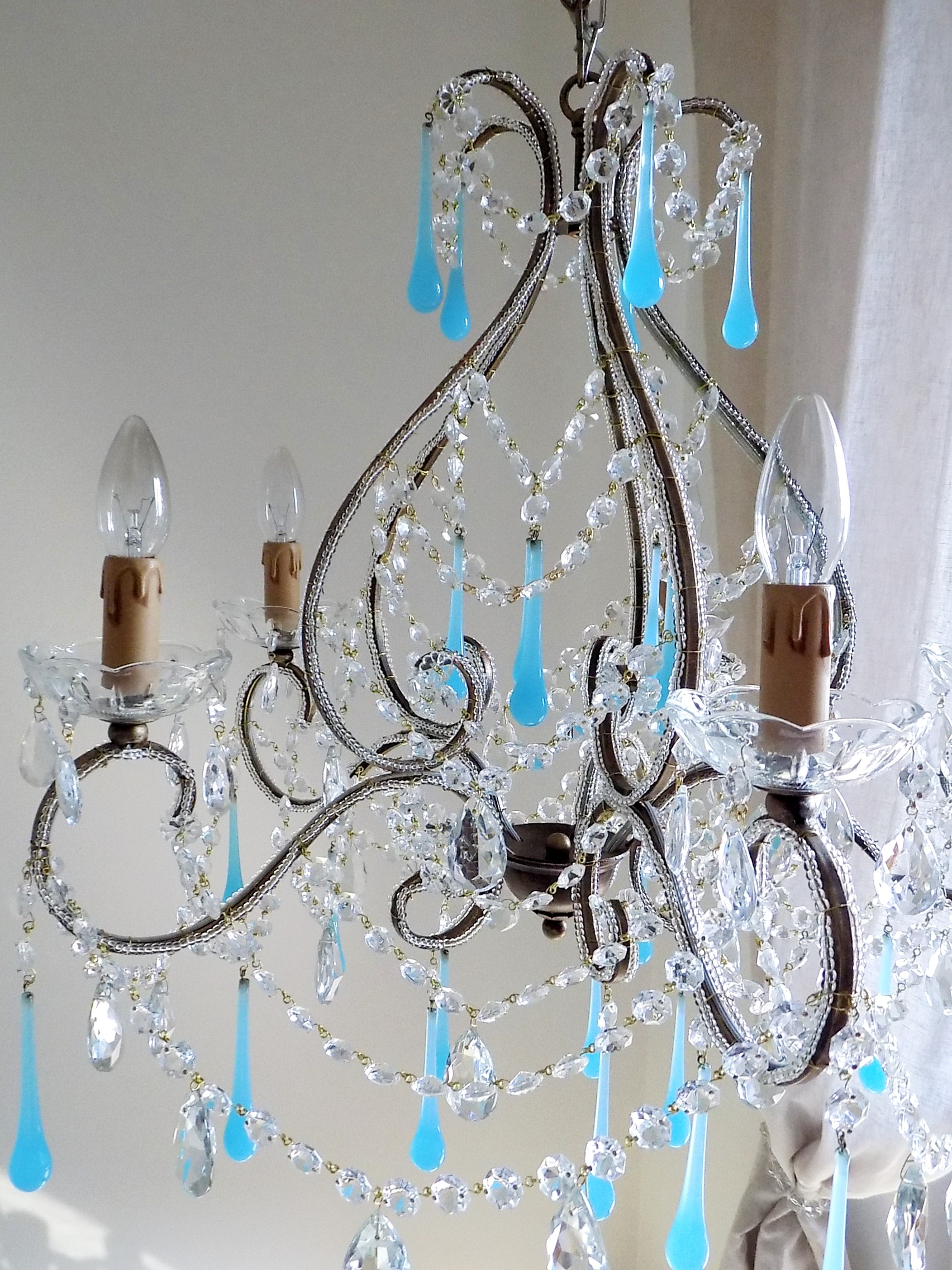 Italian vintage 9 arms chandelier with rare shaped crystals